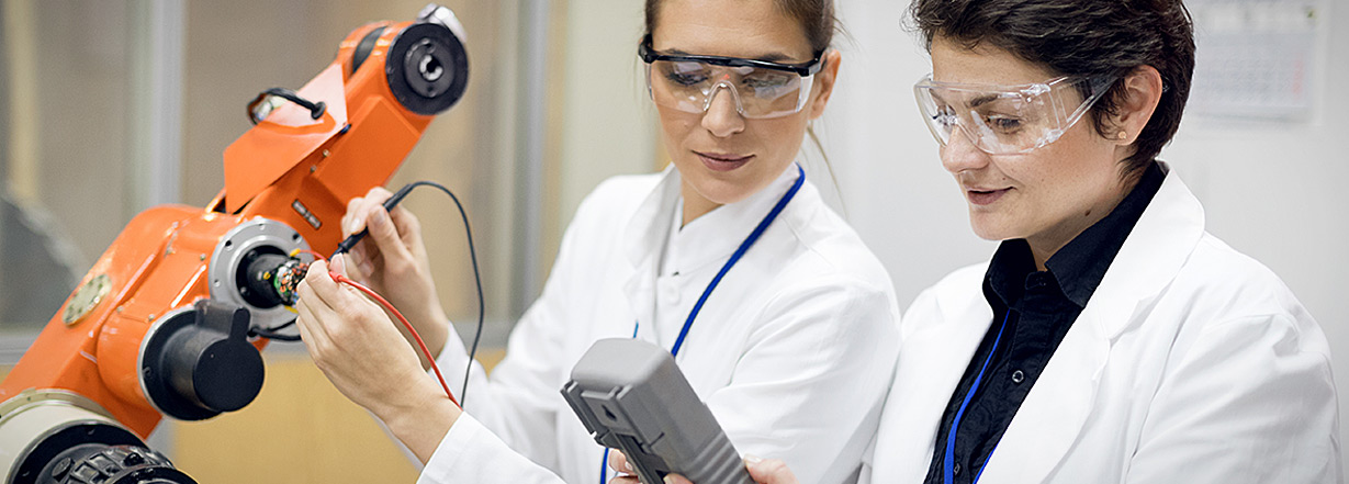 Two engineer women working in lab environment
